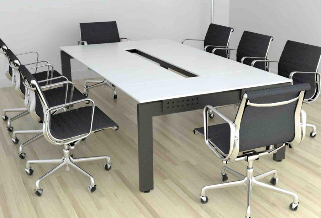 sala de juntas con apertura central en mesa